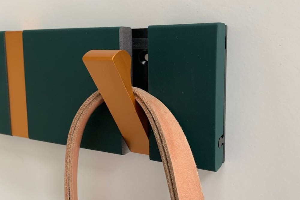 Retractable coat hooks in midnight green and copper pig